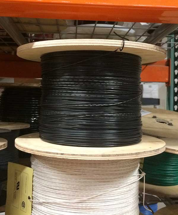 Photo of UL1007-26-7 hook up wire in warehouse.
